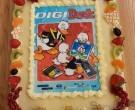 De DigiDuck op een lekkere taart